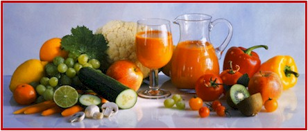 Photo of various fruits and vegetables and a pitcher and glass of juice.